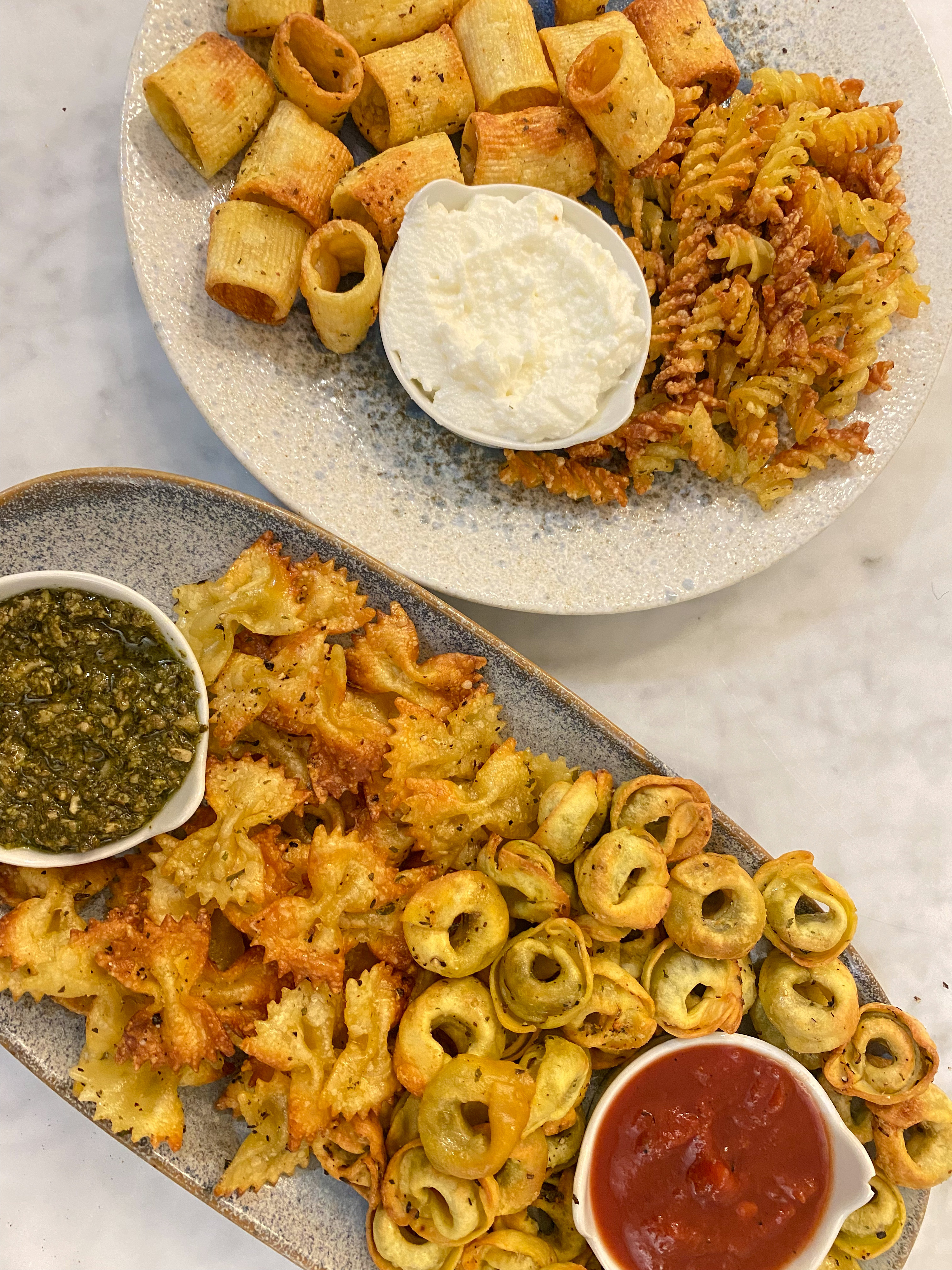 Air fried pasta chips with different dipping sauces.