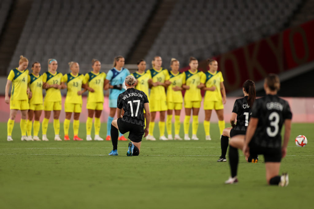 New Zealand players taking the knee before the match