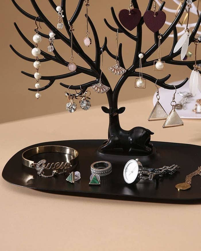 Jewellery stand in shape of a tree with earrings, rings and bracelets on it