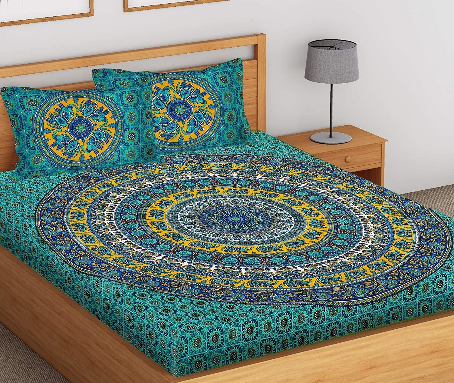 A double king size bedsheet with 2 pillow covers in green and yellow with a mandala design on it