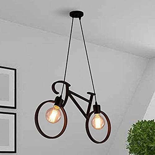 A hanging lamp with two bulbs and a cover that looks like a bicycle with wheels