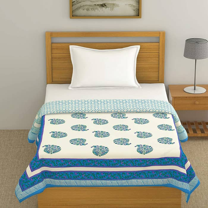 A blue and white cotton dohar with block print motifs