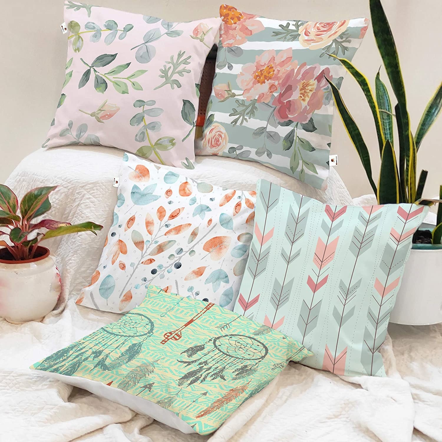 5 cotton cushion covers with prints that look like watercolour paintings in a light colourpalette