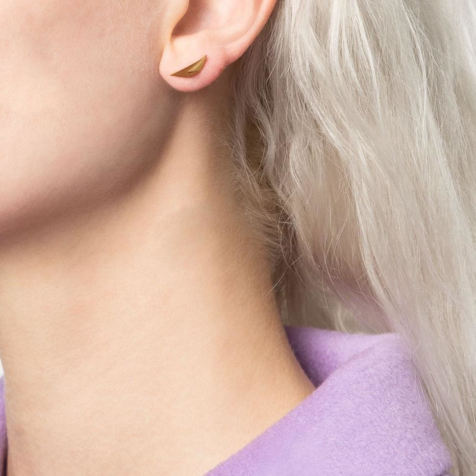 close up of the prizm stud on a model's ear