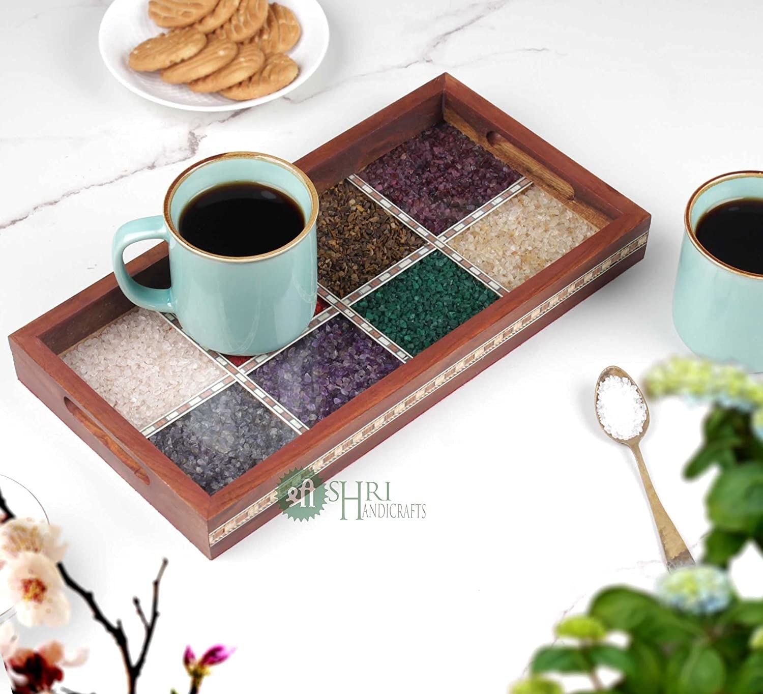 A wooden tray with gemstone painting in different colours painted on its base