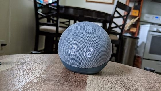 reviewer's picture of the alexa in their kitchen