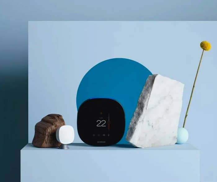 the smart thermostat surrounded by decorative stones