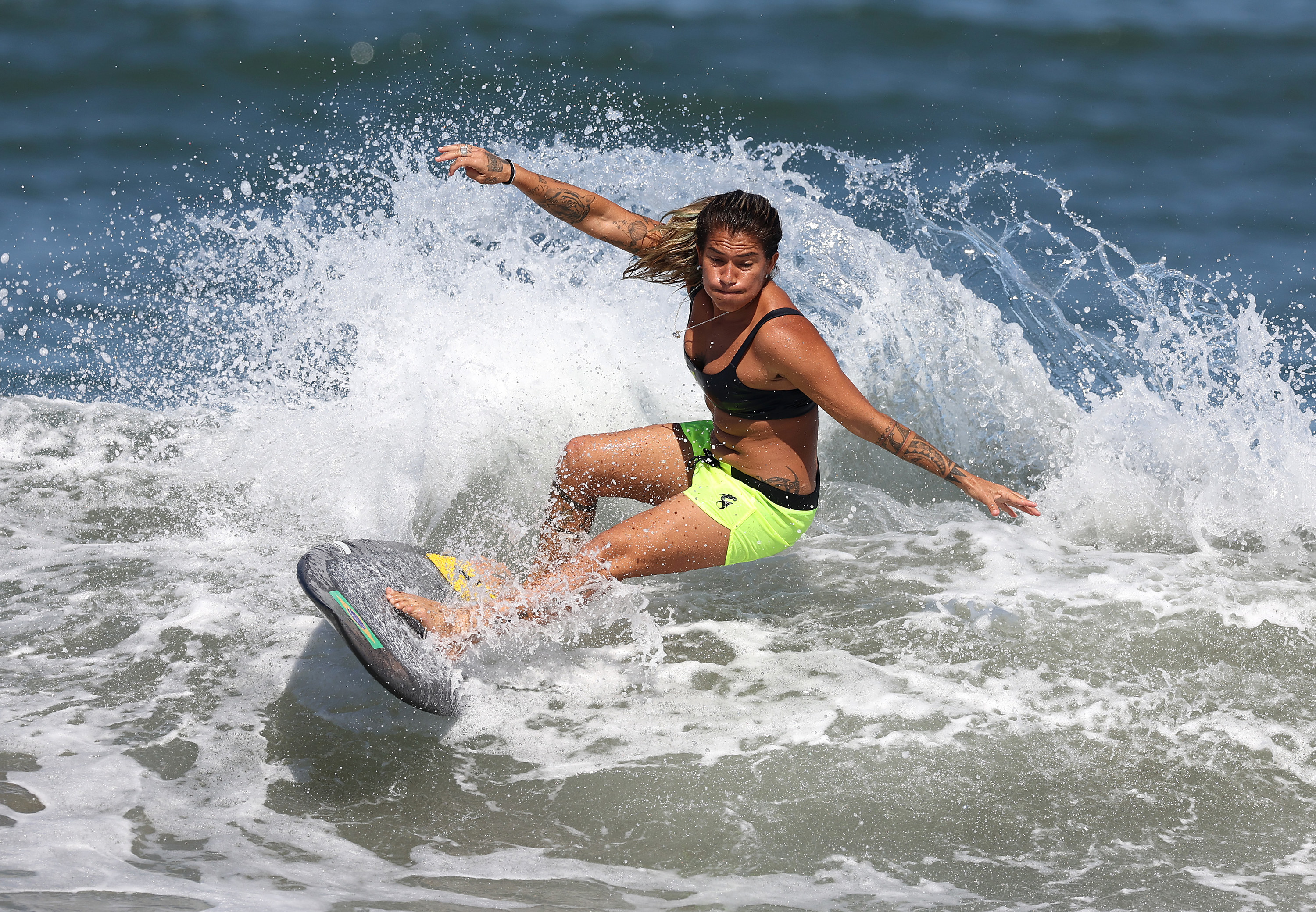 Silvana catching a wave and practicing in Japan