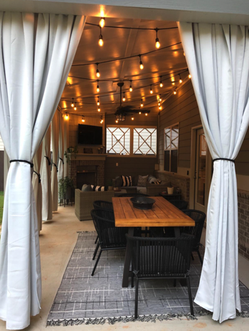 reviewer image of the curtains added to patio and tied up on the sides