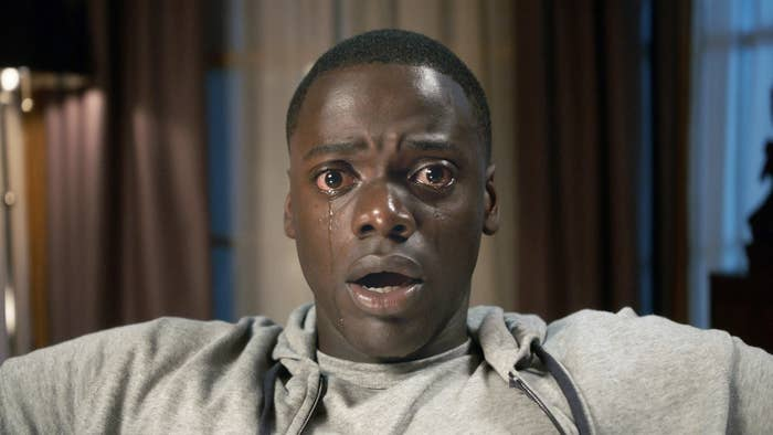 Daniel Kaluuya as Chris in Get Out, sitting in a chair frozen, tears streaming from his eyes