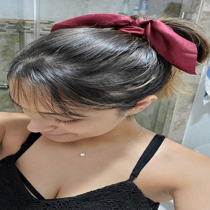 ribbon in red on reviewer's ponytail