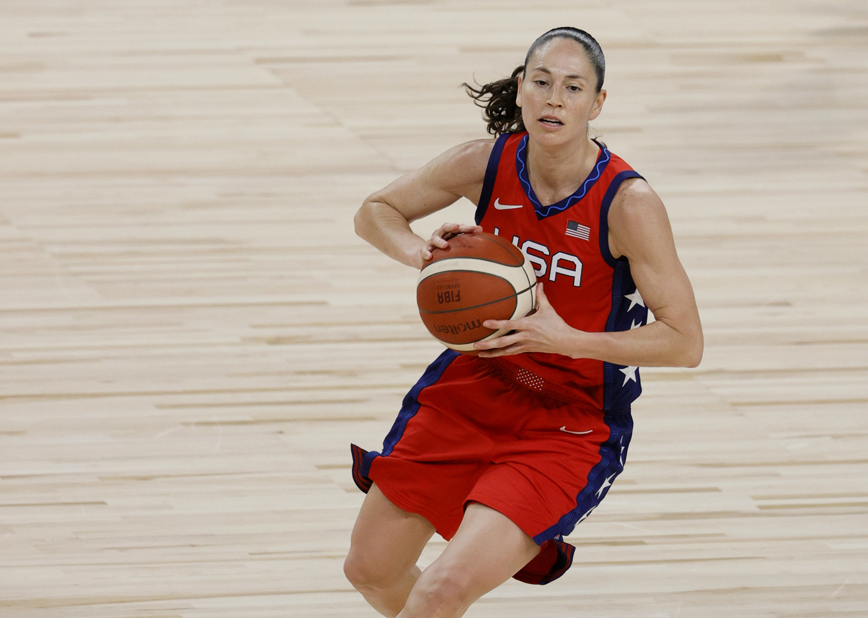 Sue playing basketball for Team USA