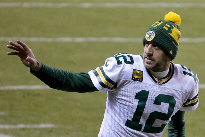 Aaron Rodgers waves to the sideline in Packers uniform