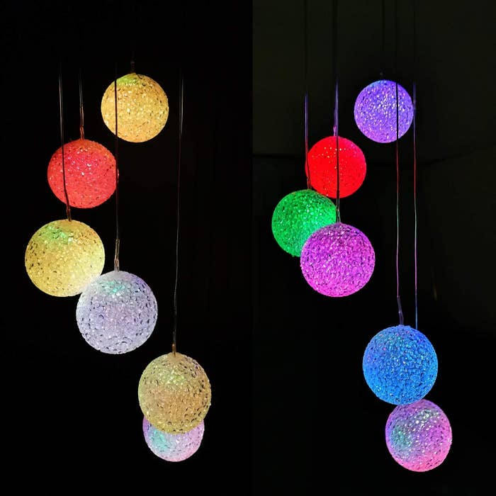 The wind chimes at night glowing in different colors