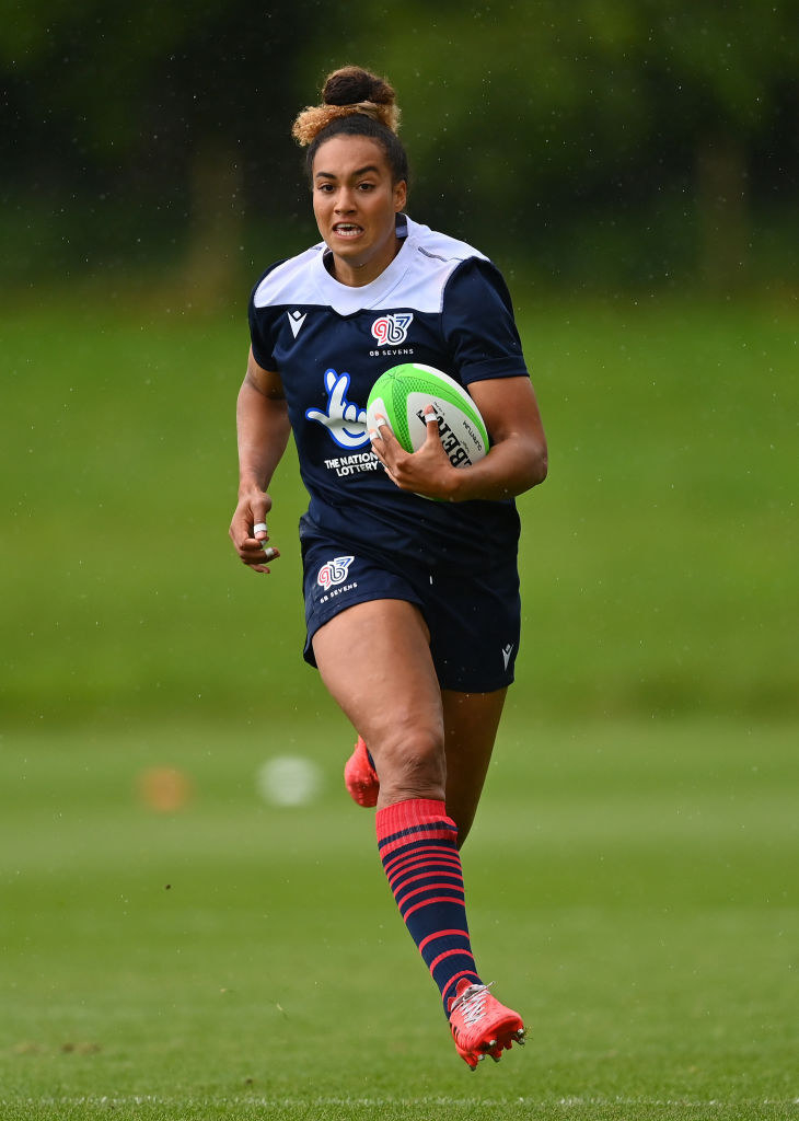 Megan running with a rugby ball