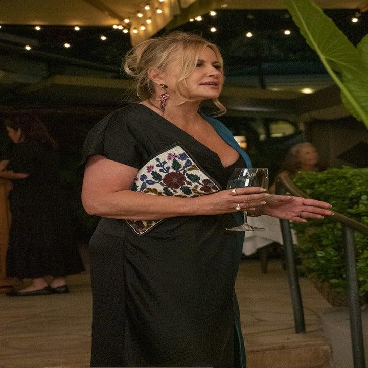 Jennifer Collidge in an open air restaurant