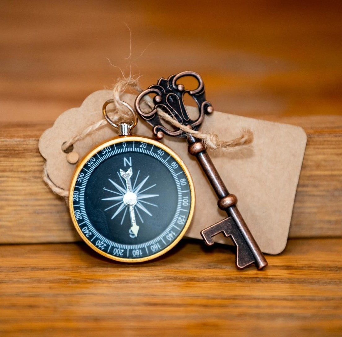 The compass ornament with a bottle opener key and a tag tied to it