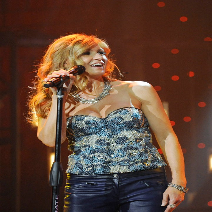 Connie Britton sings at a concert on NASHVILLE