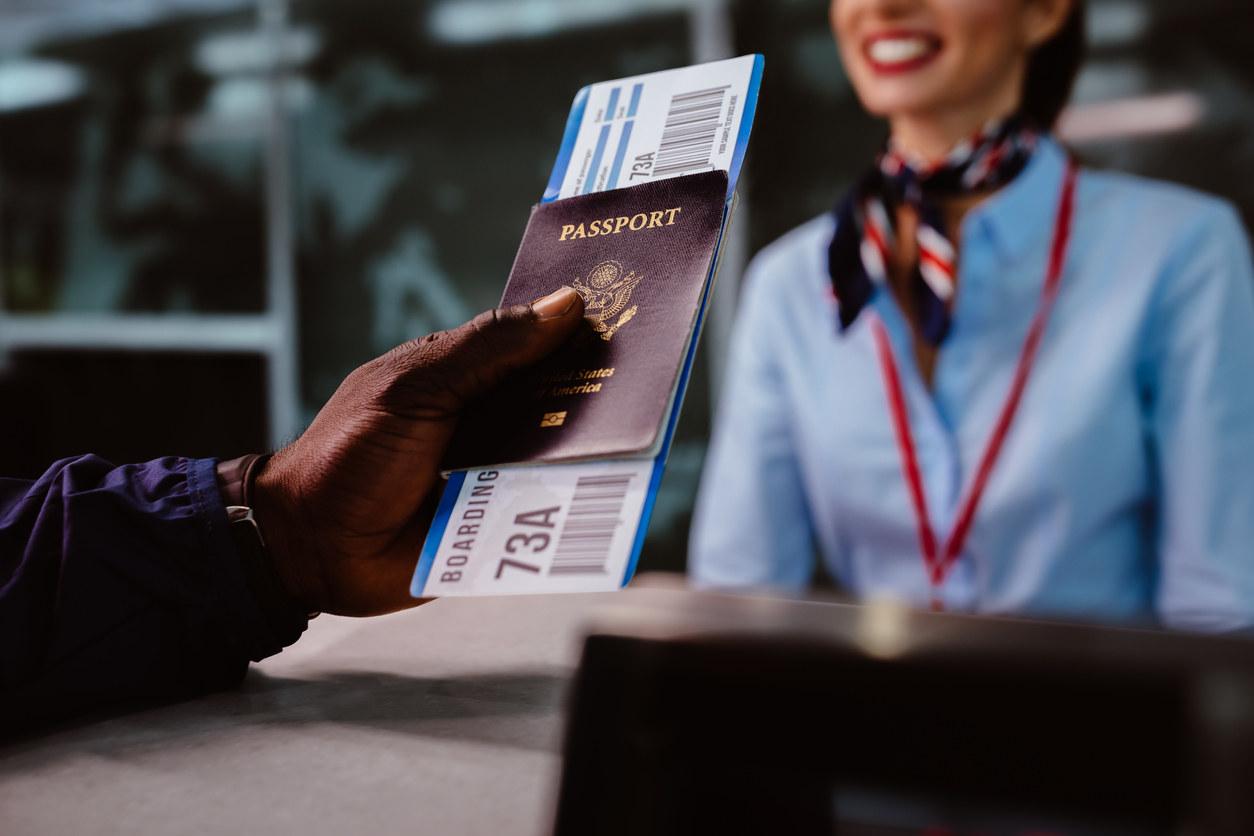 A traveler holding a passport