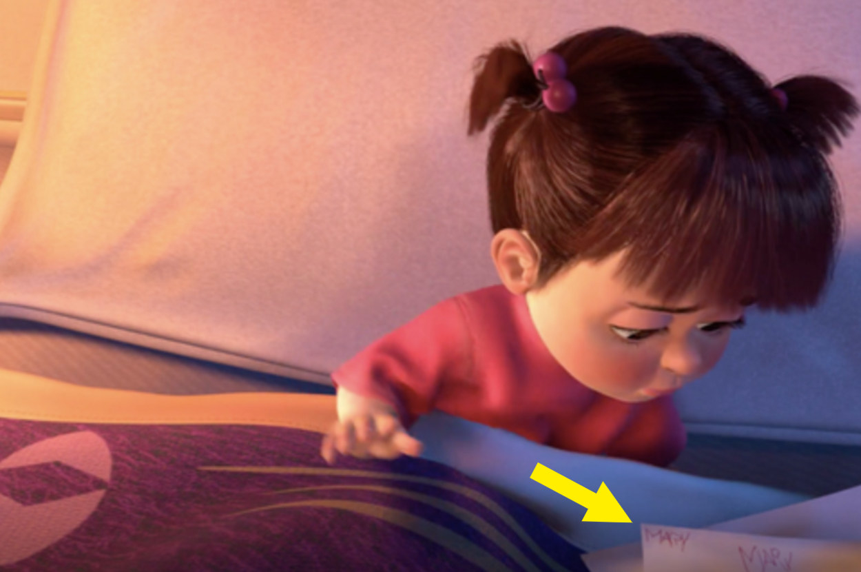 A scene from Monsters Inc. showing that Boo signed her drawings as Mary