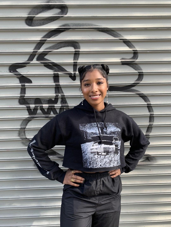 a model wearing the black miles dirt cropped hoodie