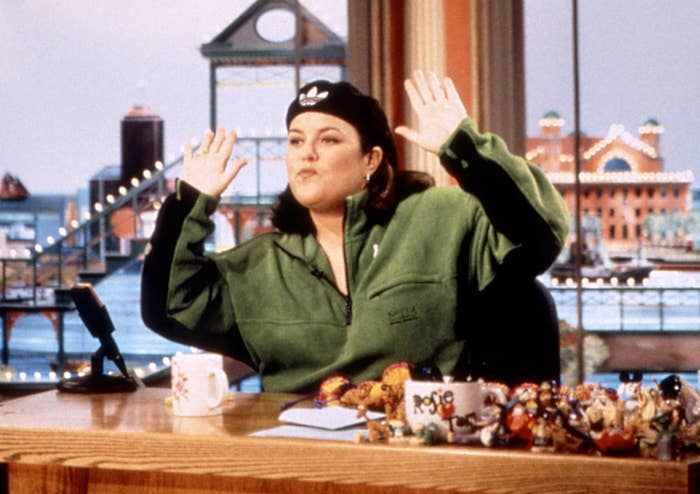 Rosie sits at her desk on her old talk show