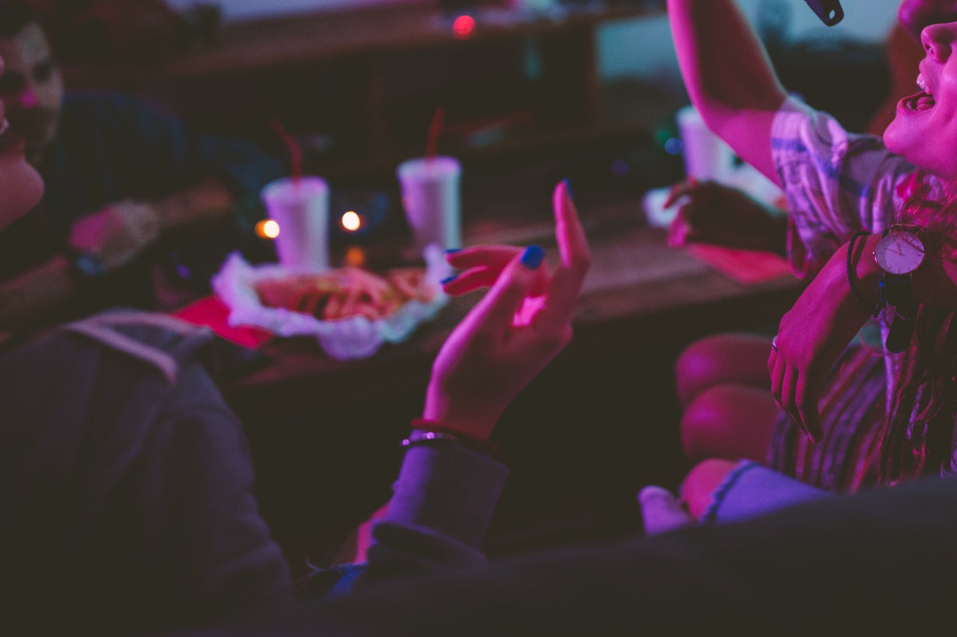 A group of people sitting on a couch at a party