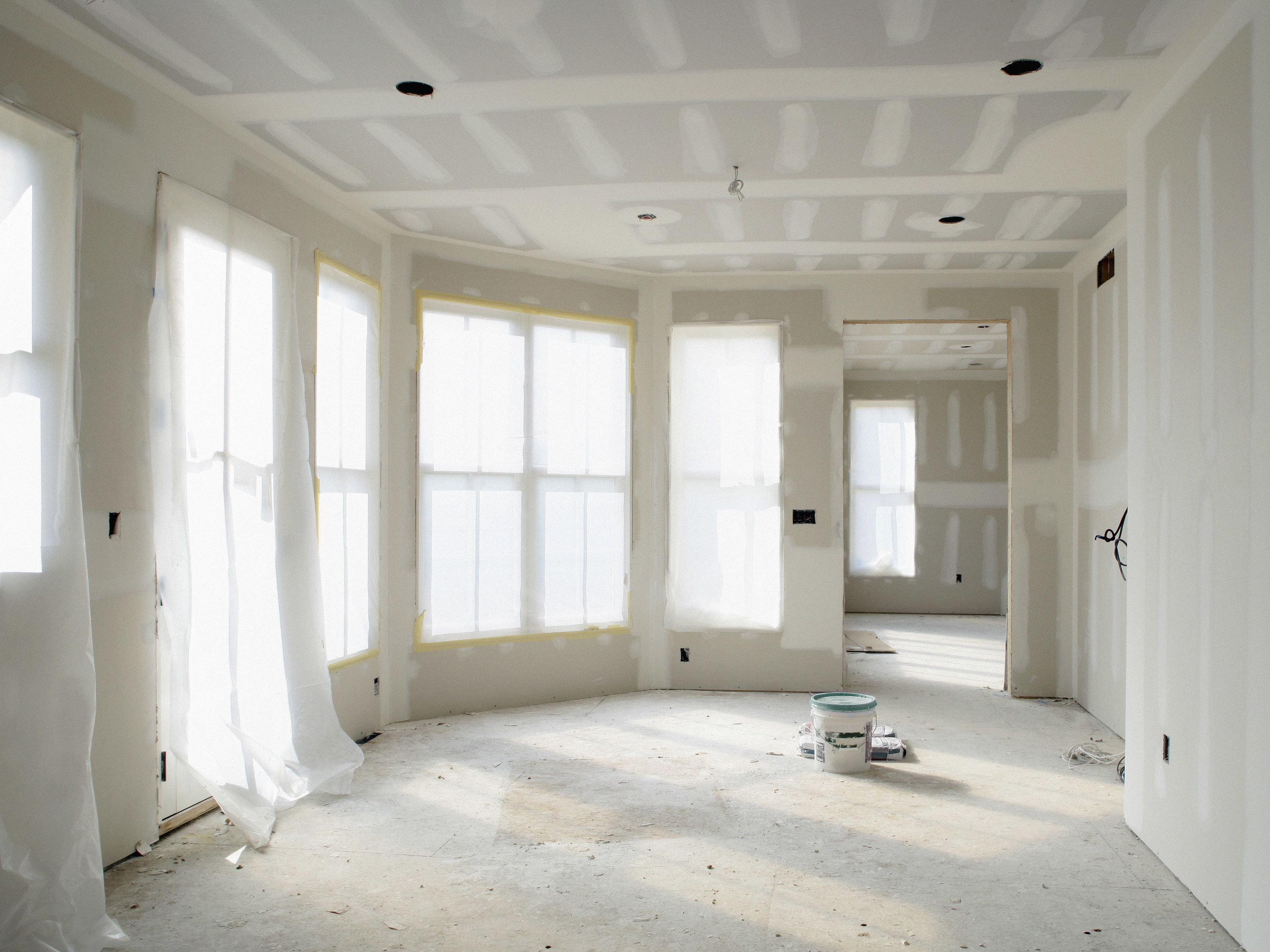 The interior of a room being remodeled with drywall