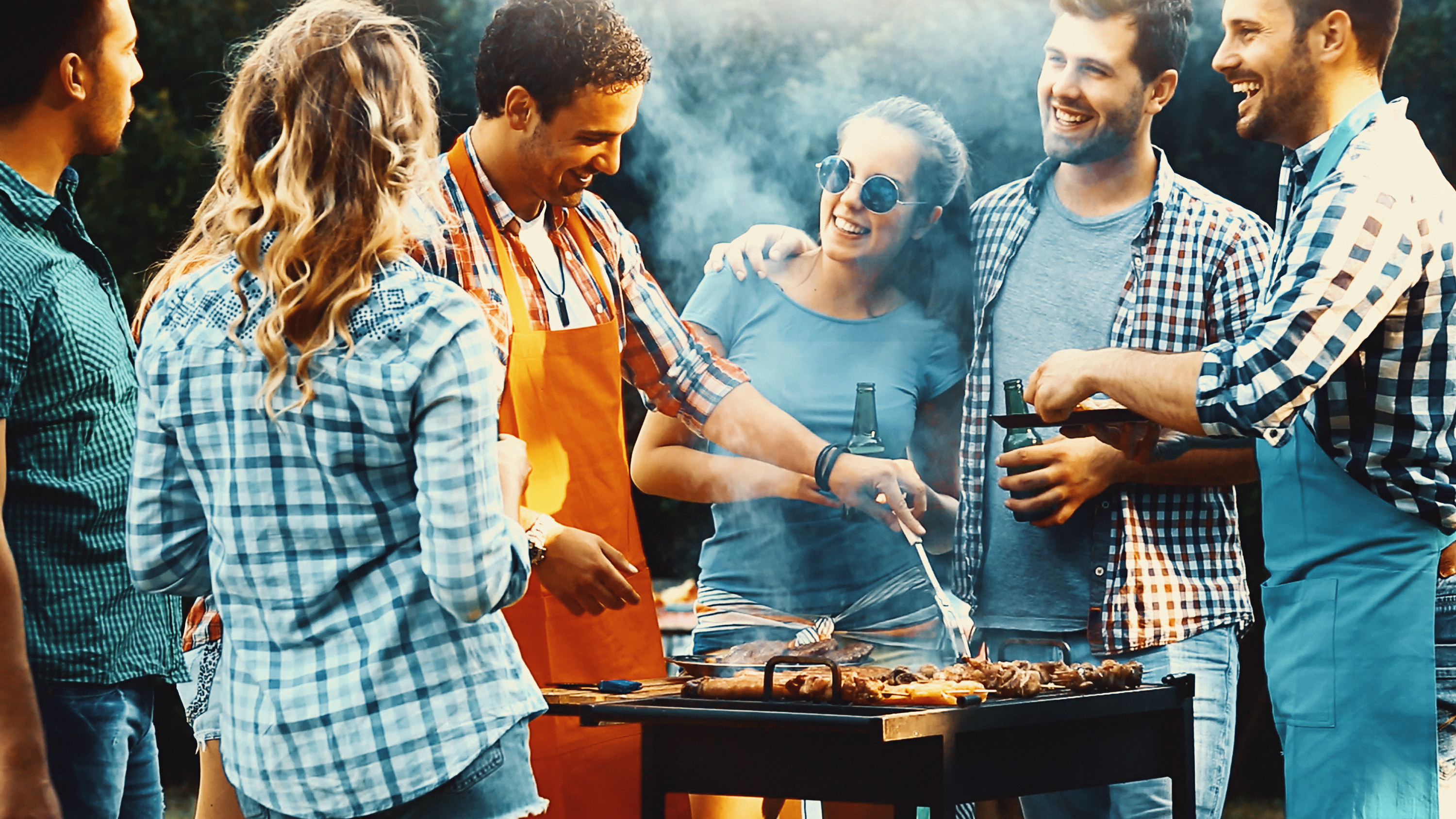 A group of people at a barbecue