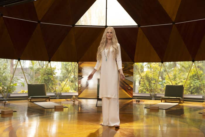 Nicole Kidman as Masha dressed in an all-white top; she is standing in a room filled with natural light