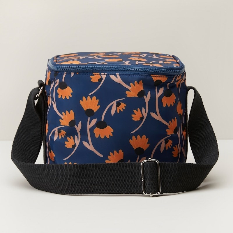 a rectangular lunch bag with a floral pattern on it