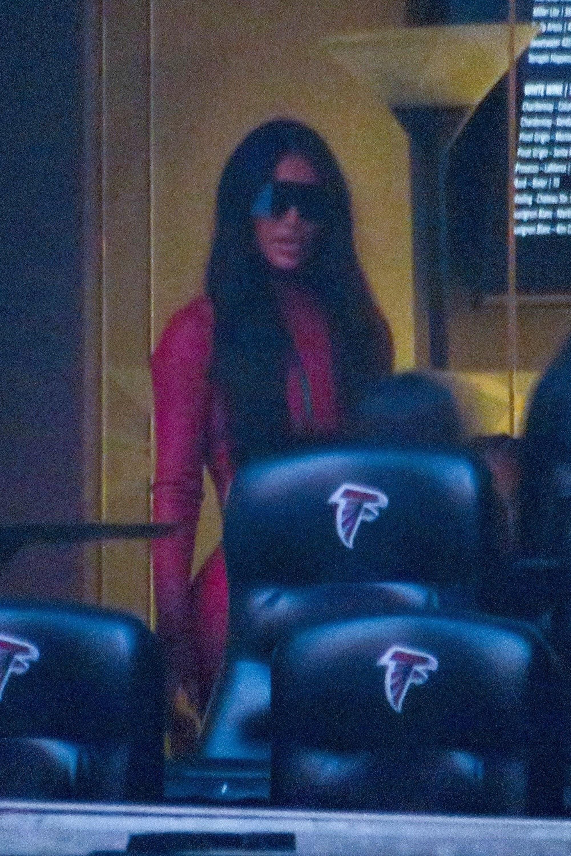 Kim Kardashian is pictured wearing red during Kanye West's Donda album listening event