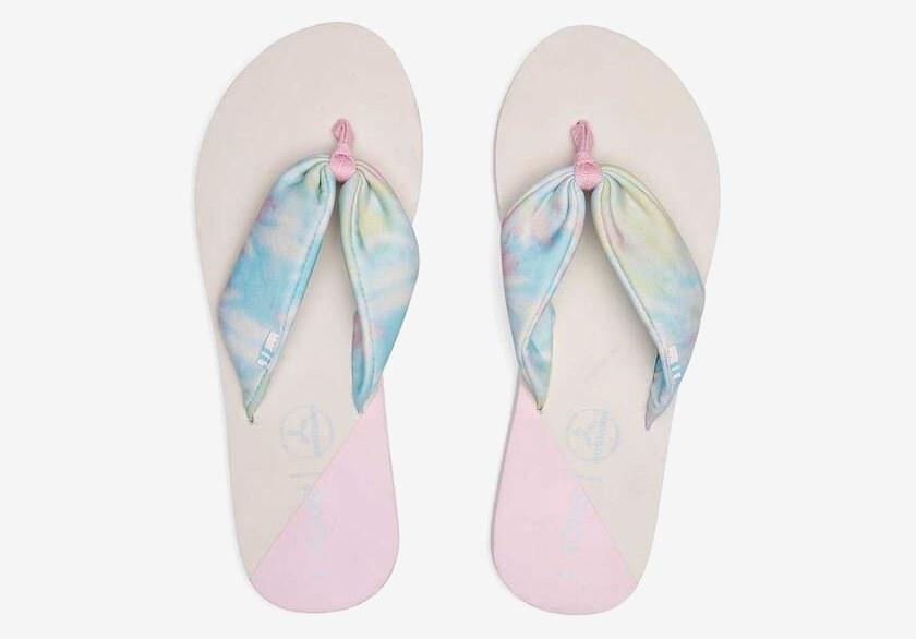 the tie-dye flip flops in multi-white