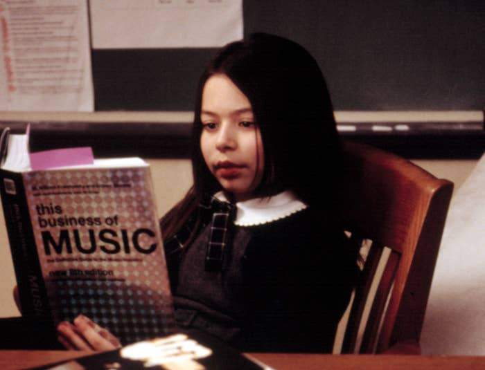 """Summer sits reading a book called """"The Business of Music"""""""