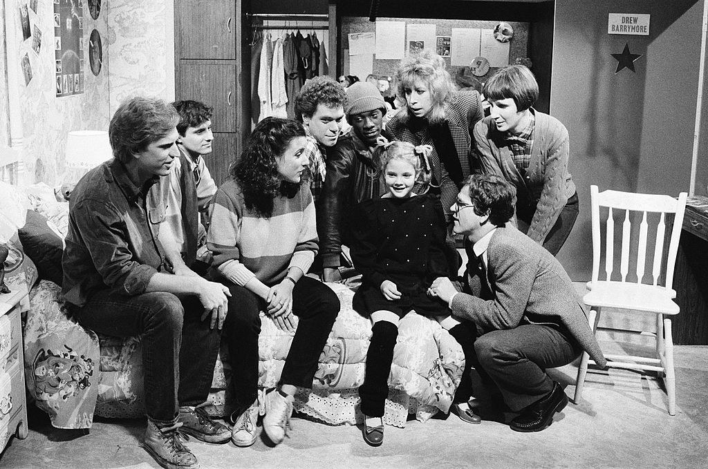 Drew Barrymore doing a skit for SNL, with the cast surrounding her