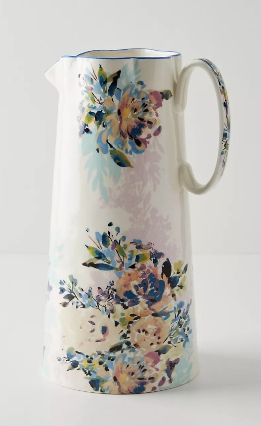 A cream pitcher hand-painted with multi-colored florals