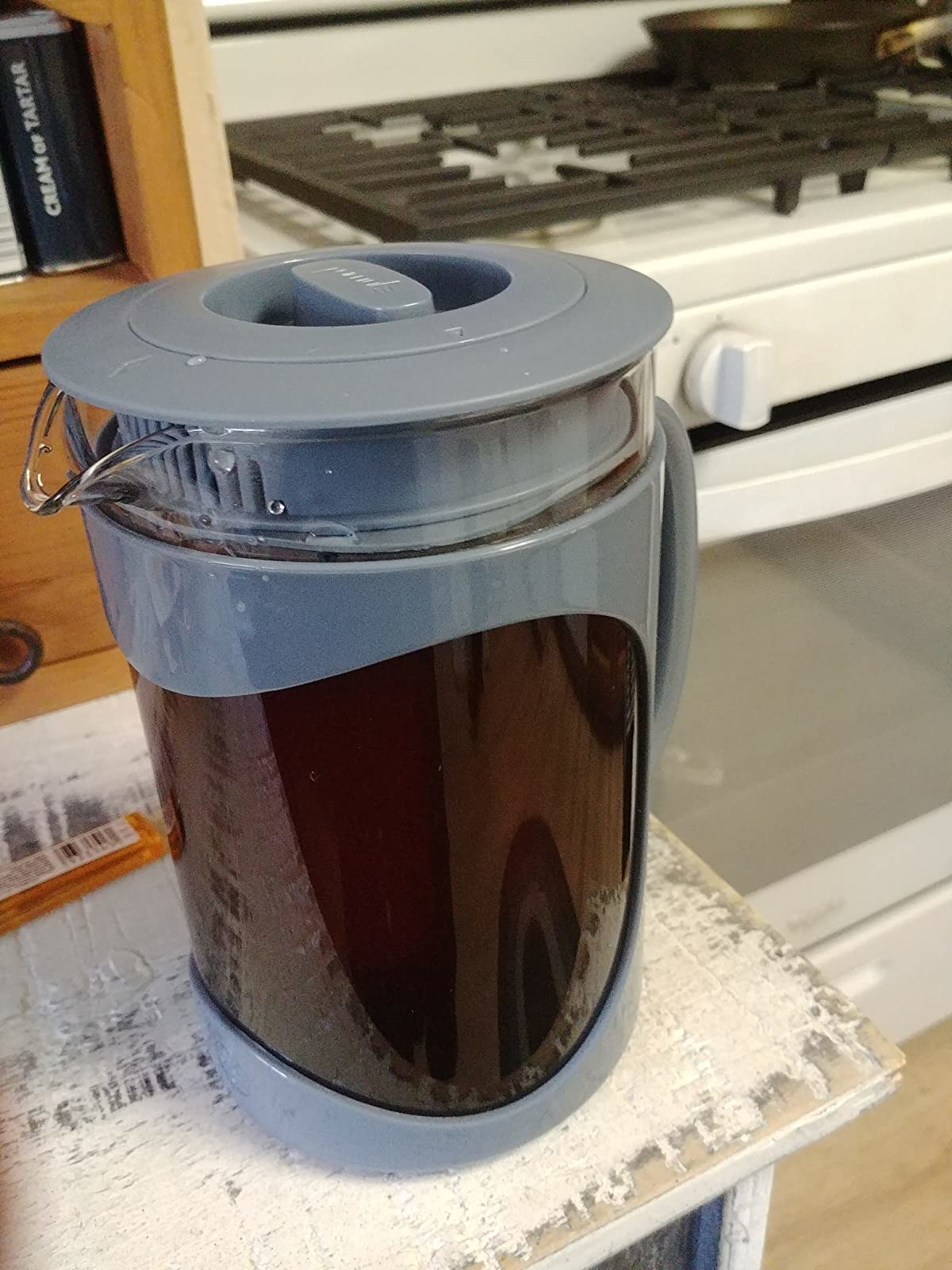 reviewer image of the blue primula cold brew maker full of cold brew