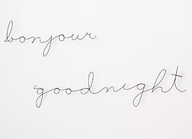 """Metal, wire script sculptures that read """"goodnight"""" and """"bonjour"""""""