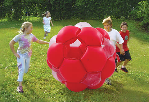 kids playing with giant hamster ball