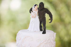a bride and bigfoot cake topper at a wedding