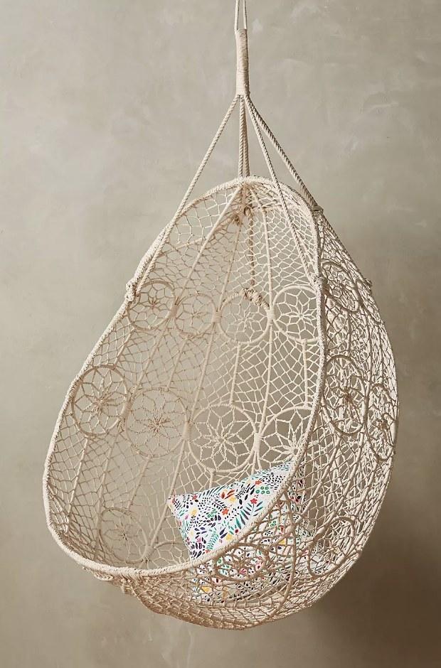 A handwoven, macramé hanging chair