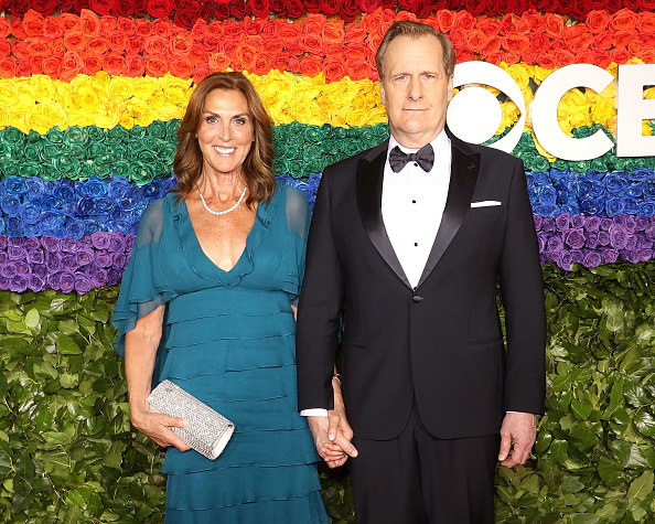 Kathleen and Jeff holding hands on the red carpet