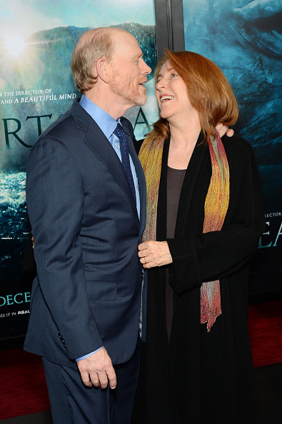 Ron Howard and Cheryl looking at each other on the red carpet