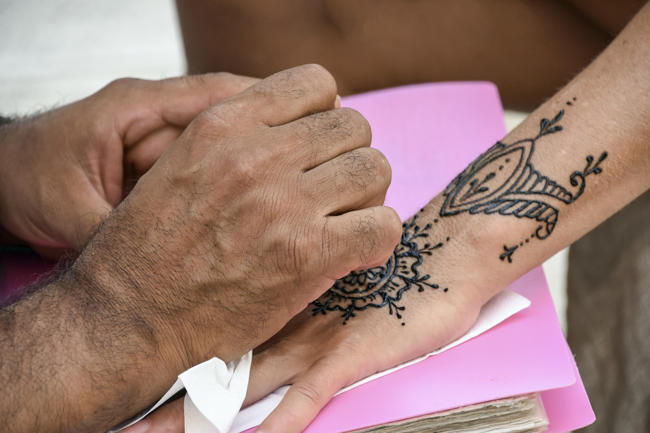 Someone being given a henna tattoo