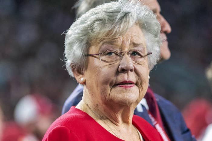 Kay Ivey is shown wearing glasses and looking off-camera