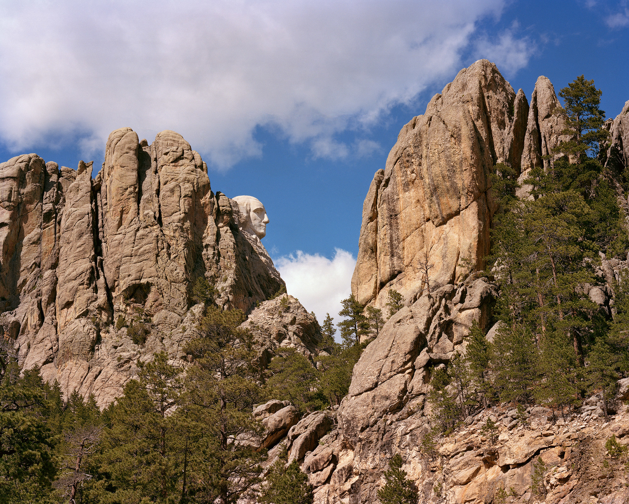 The face of George Washington appears in profile in the red rock