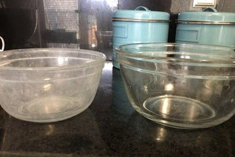 white cast pyrex bowl and then clean, clear pyrex bowl