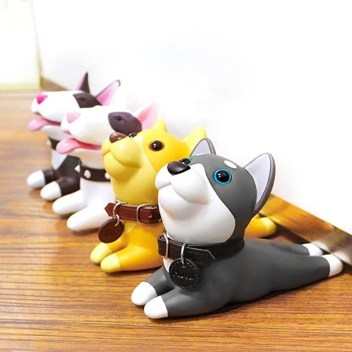 line of dog shaped doorstops