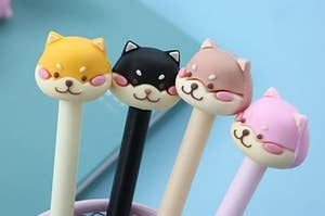 pens topped with mean looking shiba heads