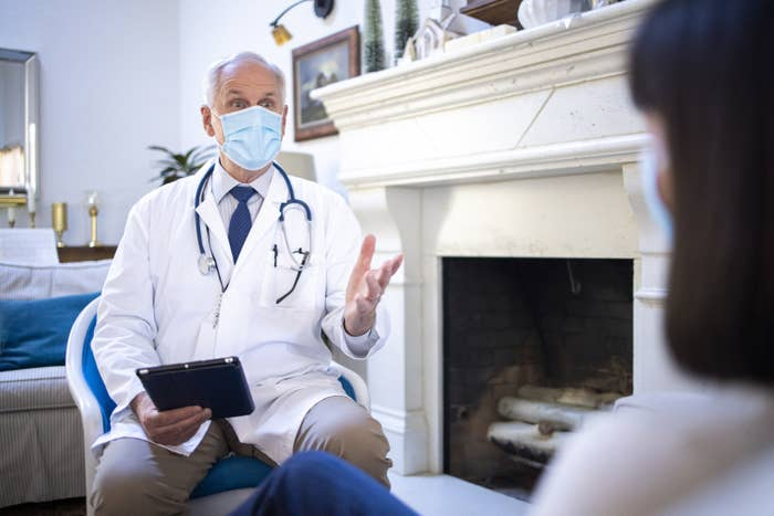 Doctor visiting a patient in their home